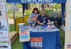 Photo of Christopher Auker-Howlett and Janet Murden (GCN Volunteer) manning the Combat Stress stall in Cheltenham, 2019