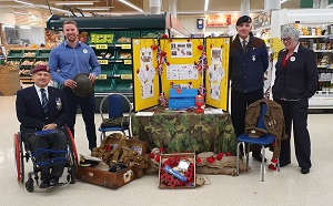 Photo of Christopher Auker-Howlett with Tesco Store Managers and Veteran Volunteer collecting for the Royal British Legion Poppy Appeal, 2019, at the Churchdown Tesco Store